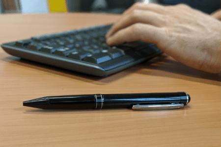 pen next to keyboard